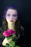 Woman in the veil with a bouquet of roses Royalty Free Stock Photography