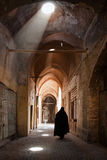 Woman in Veil Passing through Grand Old Bazaar of Yazd Stock Image