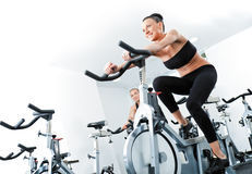 Woman veloargometer gim fitness Royalty Free Stock Photography