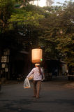 Woman vendor carrying on head in Vietnam. Stock Image