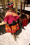 Woman vendor- Peru. Traditionally dressed Quechua woman selling handicrafts near the Incan ruins in Ollantaytambo (Sacred Valley), Peru Royalty Free Stock Photos