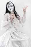 Woman with venetian mask. Woman in white wedding dress with venetian mask Royalty Free Stock Images