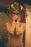 Woman in venetian mask. In city Royalty Free Stock Image