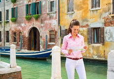 Woman in venice, italy looking at map Stock Photo