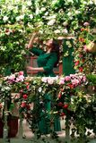 Woman on the veranda with flowers Stock Image