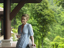 Woman In Veranda With Glass Of Water Royalty Free Stock Photography