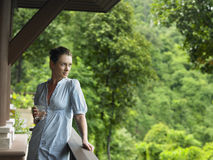 Woman In Veranda With Glass Of Water Stock Images