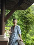 Woman In Veranda With Glass Of Water Royalty Free Stock Image