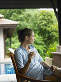 Woman In Veranda With Glass Of Water Royalty Free Stock Photo