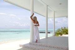 Tropic woman on the veranda Stock Image