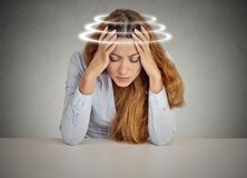 Woman with vertigo. Young female patient suffering from dizziness. Closeup woman with vertigo. Young female patient suffering from dizziness Royalty Free Stock Images