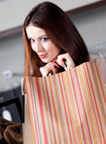 Woman is very pleased with bargains. Pleased with bargains woman carries paper bags Royalty Free Stock Photos