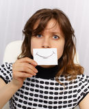Woman with very unnatural smile on face Stock Photography