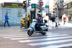 Woman on Vespa Stock Photo