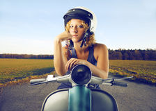 Woman on a vespa Stock Image