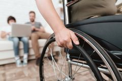Woman veteran in wheelchair returned from army. Close-up photo veteran woman in a wheelchair. Woman veteran in wheelchair returned from army. Close-up photo Royalty Free Stock Photos