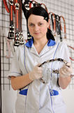 Woman veterinarian chooses collar and leash Royalty Free Stock Photography