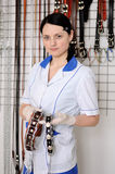 Woman veterinarian chooses collar and leash Stock Images