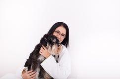 Woman veterinarian with Miniature schnauzer Stock Photos