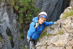 Woman on via ferrata Royalty Free Stock Image