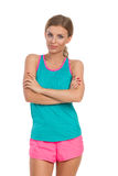 Woman In Vibrant Sports Clothes Posing With Arms Crossed Royalty Free Stock Photo