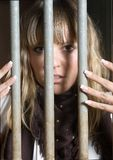 Woman victim of violence. Woman in a jail of her hearth Stock Image