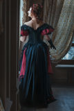 Woman in Victorian dress back. Royalty Free Stock Photos