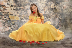 Woman in Victorian Dress Holding Rose Royalty Free Stock Photo