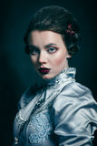 Woman in victorian dress Royalty Free Stock Images