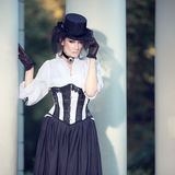 Woman in Victorian dress. Mysterious woman in Victorian dress royalty free stock photos