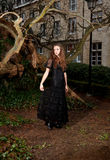 Woman in Victorian dress in the park Royalty Free Stock Photo