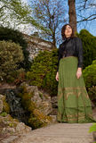 Woman in Victorian dress in the park with waterfall Stock Photography