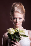 Woman in victorian dress with roses in hands Royalty Free Stock Photography