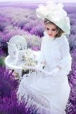 Woman in victorian lavender field royalty free stock photography