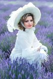 Woman in victorian lavender field royalty free stock image