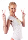 Woman with victory sign. Woman showing victory gesture at isolated background Royalty Free Stock Image