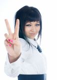 Woman with victory sign. Woman showing victory gesture, Focus on sign. Isolated on white Royalty Free Stock Image