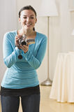 Woman with video camera royalty free stock photography