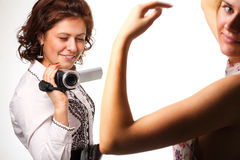 Woman with a video camera. On white background Royalty Free Stock Photography