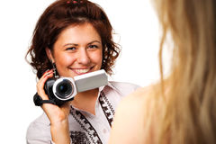 Woman with a video camera. On white background Stock Photo
