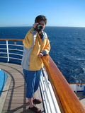 Woman Video Camera. Woman holding video camera standing on deck fo cruise ship Stock Photo