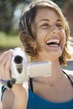 Woman with video camera. royalty free stock photos