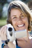Woman with video camera. Royalty Free Stock Photography