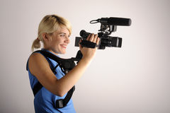 Woman with video camera Stock Images