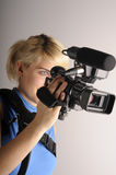 Woman with video camera. Blond young woman hold video camera in hand Royalty Free Stock Photography