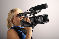 Woman with video camera Royalty Free Stock Photo