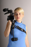 Woman with video camera. Blond woman hold video camera in hand Royalty Free Stock Images
