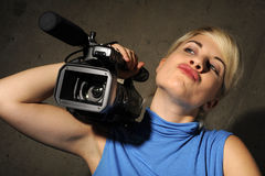 Woman with video camera Royalty Free Stock Photos