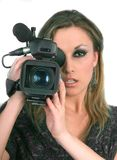 Woman with video camera on blue screen. Woman video camera blue screen royalty free stock photography