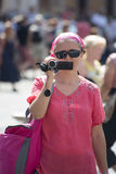 Woman with a video camera stock images